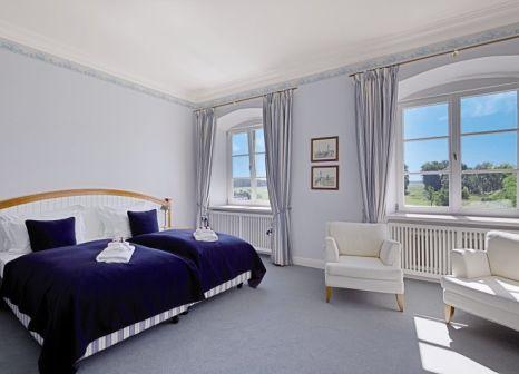 Hotelzimmer mit Mountainbike im Schlossgut Gross Schwansee