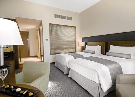 Hotelzimmer mit Tischtennis im Grand Millennium Al Wahda