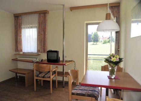 Hotelzimmer mit Mountainbike im Reiterhof Runding