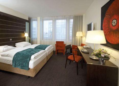 Hotelzimmer mit Mountainbike im Imperial