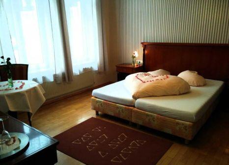 Hotelzimmer mit Mountainbike im Kurhotel Quellenhof