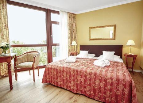 Hotelzimmer mit Mountainbike im Cliff Hotel Rügen