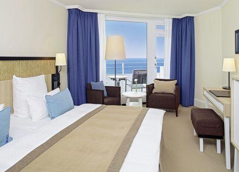 Hotelzimmer mit Mountainbike im Hotel Neptun Warnemünde