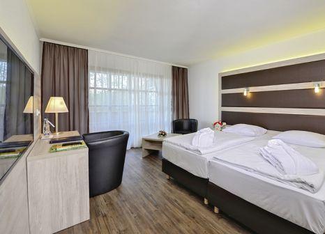 Hotelzimmer mit Mountainbike im Michel & Friends Hotel Waldkirchen