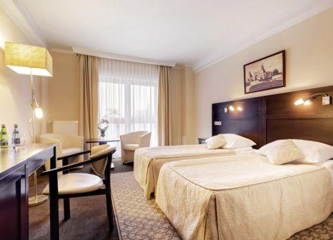 Hotelzimmer mit Mountainbike im Hotel Aurora Family & Spa