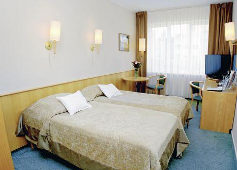Hotelzimmer mit Mountainbike im Hotel Senator