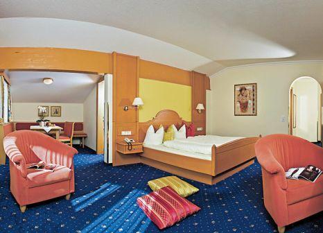 Hotelzimmer mit Mountainbike im Hotel Kohlerhof