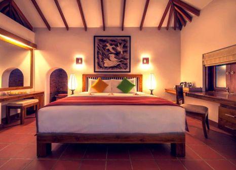 Hotelzimmer mit Yoga im Ranweli Holiday Village