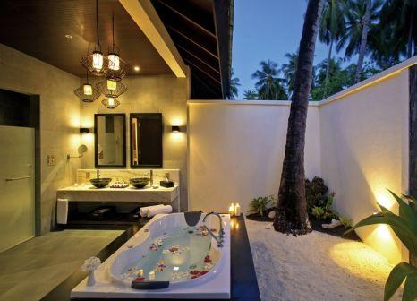 Hotelzimmer mit Volleyball im Atmosphere Kanifushi Maldives