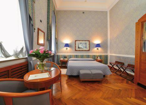 Hotelzimmer mit Mountainbike im Grand Hotel Ortigia