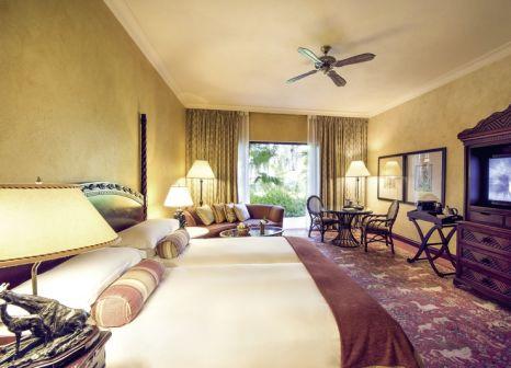 Hotelzimmer mit Mountainbike im SunThe Palace