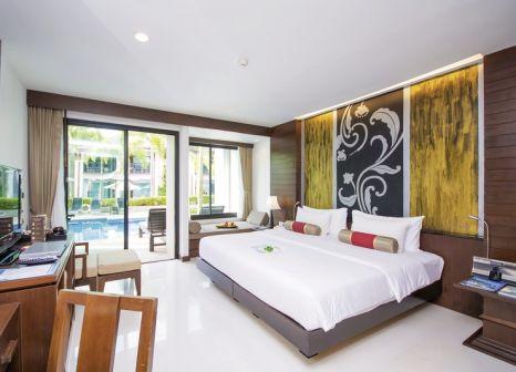 Hotelzimmer mit Mountainbike im La Flora Khao Lak