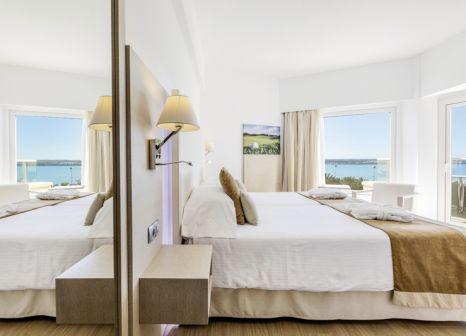 Hotelzimmer mit Mountainbike im Hotel Pure Salt Garonda