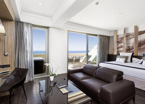 Hotelzimmer mit Mountainbike im Pure Salt Port Adriano