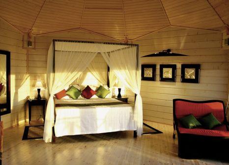 Hotelzimmer mit Tischtennis im Komandoo Island Resort & Spa