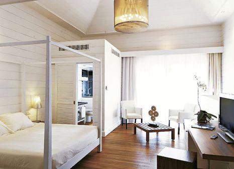 Hotelzimmer mit Mountainbike im Mauricia Beachcomber Resort & Spa