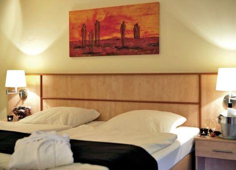 Hotelzimmer mit Mountainbike im Ferien- und Freizeitpark Weissenhäuser Strand - Strandhotel
