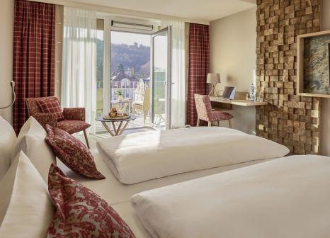 Hotelzimmer mit Mountainbike im Dorint Resort & Spa Bad Brückenau