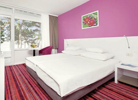 Hotelzimmer mit Minigolf im Hotel Zora