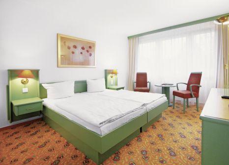 Hotelzimmer mit Mountainbike im IFA Schöneck Hotel & Ferienpark