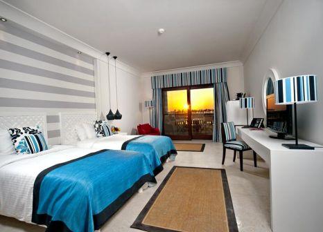 Hotelzimmer mit Mountainbike im Juweira Boutique Hotel