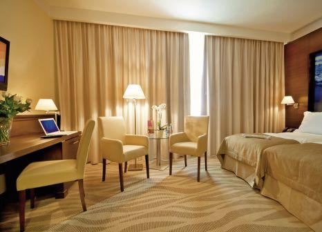 Hotelzimmer mit Hochstuhl im Radisson Blu Hotel Gdansk