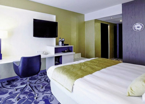 Hotelzimmer mit Mountainbike im Radisson Blu Hotel, Amsterdam City Center