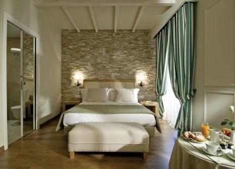 Hotelzimmer mit Mountainbike im Kurhaus Cademario