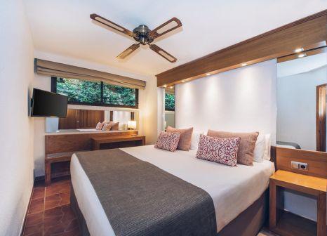 Hotelzimmer mit Mountainbike im Iberostar Suites Hotel Jardín del Sol