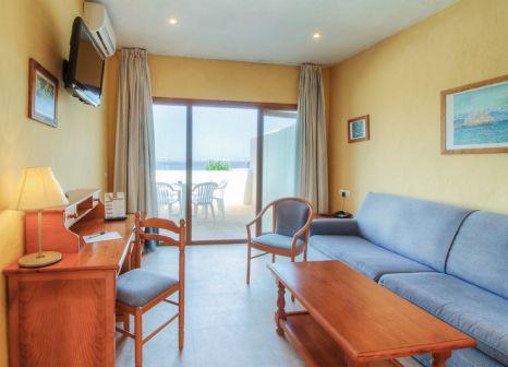 Hotelzimmer mit Mountainbike im Hotel Club Punta Prima