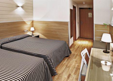 Hotelzimmer mit Mountainbike im Gran Hotel Flamingo