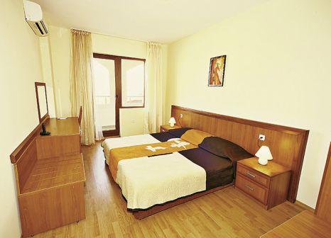 Hotelzimmer mit Mountainbike im Hotel Sunrise All Suites Resort