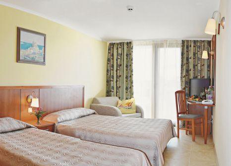 Hotelzimmer mit Mountainbike im Hotel Ralitsa Superior