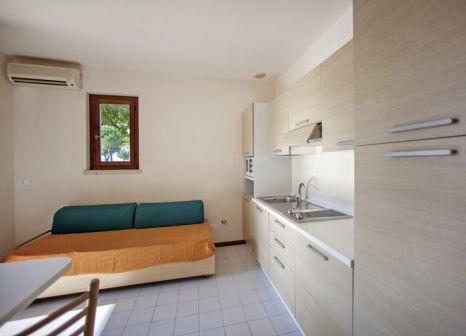 Hotelzimmer mit Mountainbike im The Garda Village