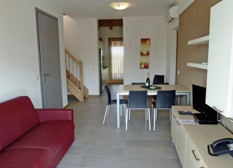 Hotelzimmer mit Sandstrand im Villaggio Laguna Blu