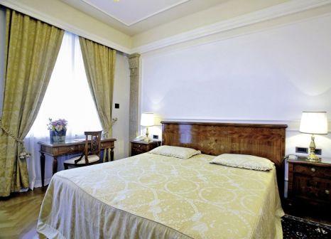 Hotelzimmer mit Mountainbike im Palace Hotel Villa Cortine