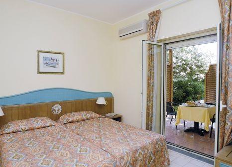 Hotelzimmer mit Golf im UNAHOTELS Naxos Beach Sicilia