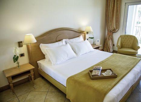 Hotelzimmer mit Mountainbike im Palace Hotel Desenzano