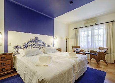 Hotelzimmer mit Mountainbike im Dom Manuel I
