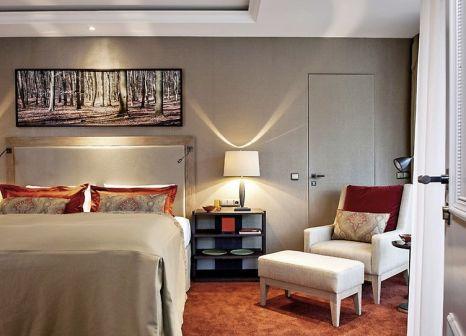 Hotelzimmer mit Mountainbike im Althoff Seehotel Überfahrt