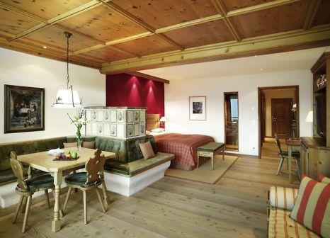 Hotelzimmer mit Mountainbike im Interalpen-Hotel Tyrol