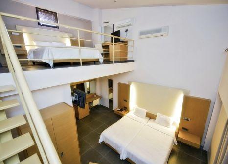 Hotelzimmer mit Mountainbike im Elite City Resort