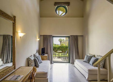 Hotelzimmer mit Mountainbike im Mitsis Rodos Maris Resort & Spa