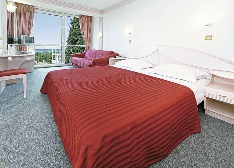 Hotelzimmer mit Mountainbike im Hotel Zorna Plava Laguna