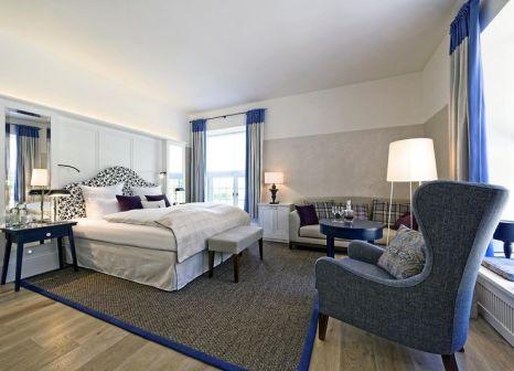 Hotelzimmer mit Mountainbike im Weissenhaus Grand Village Resort & Spa am Meer