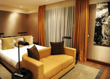 Hotelzimmer mit Hochstuhl im Radisson Blu Hotel Milan
