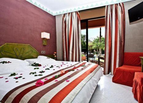 Hotelzimmer mit Tennis im Hôtel Chems