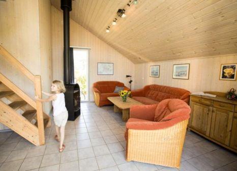 Hotelzimmer mit Mountainbike im Ferienpark Mirow