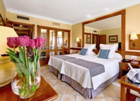 Hotelzimmer mit Mountainbike im GF Gran Costa Adeje