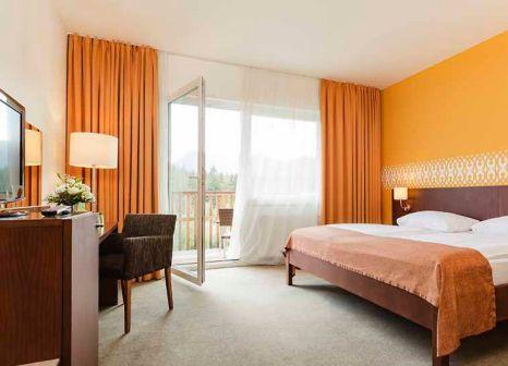 Hotelzimmer mit Mountainbike im Aldiana Club Salzkammergut